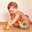 Petit Collage 100% organikus fejlesztő fa gurulós játék, bálna